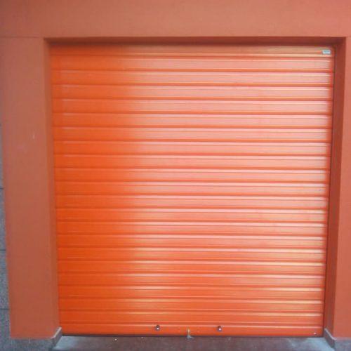puerta-enrollable-ciega-naranja